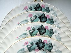 Vintage Aynsley Set of 5 Lunch Plates in Blue Leaf Pattern. Gilded and swirled shape and incredible soft colors - beautiful! Last picture shows all the pieces I have from this beautiful vintage english service - this listing is for 5 plates set! Great for your home, as a gift or for a collector!  Mark: as pictured Size: 8 3/8 Condition: excellent, no issues found  Please, ask all the questions BEFORE you buy!  BUY WITH CONFIDENCE - I HAVE BEEN SELLING ON INTERNET FOR OVER 11 YEARS
