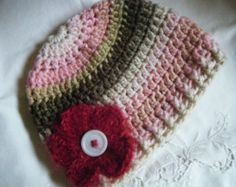 Crocheted Child's Hat with Flower.