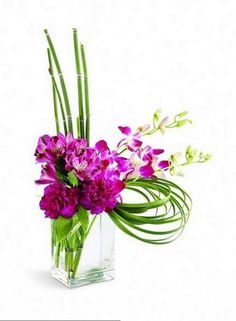 Cosmopolitan Bouquet-Fuchsia dendrobium orchids, purple alstroemeria and purple carnations showcase this cosmopolitan design. Equisetum and lily grass accent this graceful bouquet that's arranged in a contemporary glass vase. A truly elegant gift. Purple Carnations, Pink Orchids, Modern Flower Arrangements, Orchid Arrangements, Luxury Flowers, Exotic Flowers, Hotel Flowers, Same Day Flower Delivery, Flowers Online