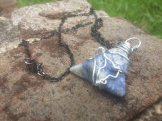 The necklace is 20 inches. On a black chain. The lapis pyramid or triangle is hand wrapped. Lapis is a very protective stone of both psychic and physical protection . It is a stone of truth and openness. Great for mediation and connection on the angel realms. It is a third eye and a throat chakras stone.