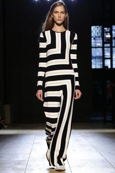 """Victoria Beckham added her trademark polish to figure-hugging knits for her Spring 2015 collection, and this bold black-and-white stripe look was one of my favorites."""