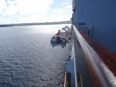 Lifeboats being lowered to use as tenders to shuttle passengers back and forward to the islands