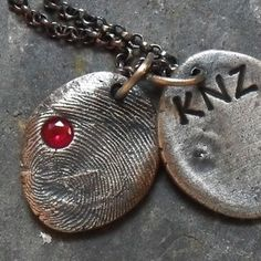 "Super awesome fingerprint jewelry!!  The business is ""Family Fingerprints"""