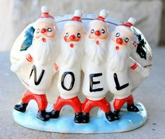 Awesome little Santa football shaped planter, with four of the little guys spelling out NOEL on their jerseys. I am paring down five generations of family collectibles, with thousands of Christmas & other vintage items; ceramics, toys, ornaments, ephemera, blow molds, linens, jewelry and lots more. I have many things; some hard to find, others more common. Some are mint; others may have a repair, chip, paint loss, etc…. Our collections are based on what we love, not what is flawless. I do...
