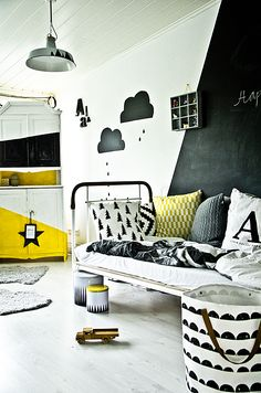 Fabulous kids' room - love the clouds on the wall and the pops of yellow