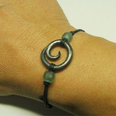 Hand forged steel spiral on an adjustable cotton cord with recycled glass beads from Sarahzona