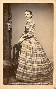 Fashionable Friday - 1860's Woman, Mad About Plaid  http://forgottenfacesandlongagoplaces.blogspot.com/2012/08/fashionable-friday-1860s-woman-mad.html