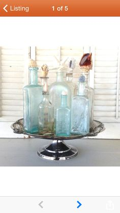 Antique apothecary jars on a cake stand