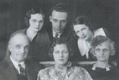 Seated L-R: Ezra Ozero, Norma Jean (Sparks) Hoch, & Iva Mae (Chenoweth) Sparks. Back row, L-R: Marie Merle (Sparks) Clay, Earl Monroe Sparks, & Mercedes Delores (Sparks) Shelhaas.  My guess is the portrait was taken sometime between 1930 & 1935. All were Darke Co. Ohio natives.