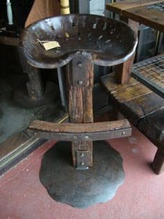 Tractor Seat with hardwood sleeper off-cut/ telephone pole cross arm + plow disc
