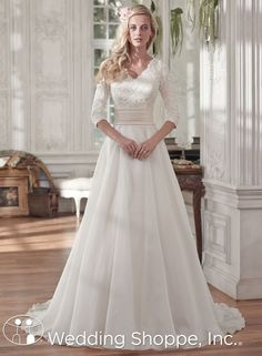 A modest lace wedding dress with 3/4 length sleeves.