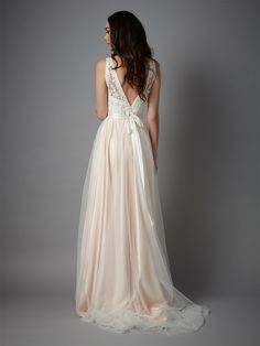 Description Details Delivery & Returns Figure-skimming, embroidered tulle meets the ultimate in romantic whimsy on the Catherine Deane, Tamsin gown. A deep-