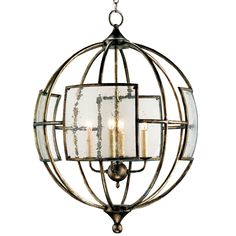 Seeded glass panels lend a glimmering touch of intrigue to the industrial design of the Broxton orb chandelier by Currey and Company. In a dining room or foyer, this wrought iron lantern hangs overhead with quiet charm.