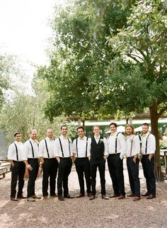 groomsmen in suspenders and bow ties: keeps the men a little cooler in warm weather and the cost of attire down…love this look!