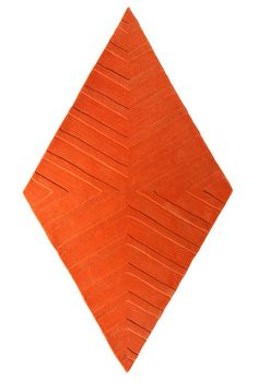 The bright orange is a fun color that brings out the undertones in the rest of the room. I love the unique diamond shape and zebra-like stripes!