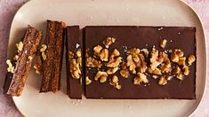 No-bake, vegan, gluten-free—this decadent dessert has a lot going for it. Dark chocolate is layered with a crunchy-chewy mixture of walnut. Desserts Crus, Vegan Desserts, Dessert Recipes, Potluck Desserts, Easter Desserts, Diabetic Desserts, Bar Recipes, Dessert Ideas, Low Carb Chocolate