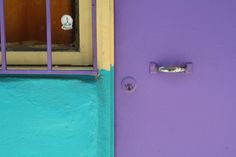 Yellow, turquoise and purple door.