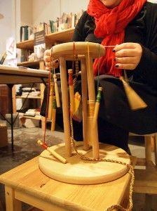 Kumihimo being woven on a Marudai.