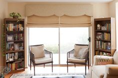 I like the shaped cornice over the Flat Roman Shades.  Nice!  Design and fabrication by Heather Rabold