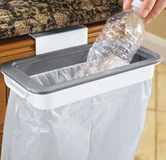 Trash bag holder locks in reused grocery bags, creating a strong, tight steal. To use simply clip onto any drawer or cabinet! No screws or installation. Bin Bag, Plastic Grocery Bags, Can Holders, Friendly Plastic, Bag Clips, Garbage Can, Trash Bag, Plastic Laundry Basket, Crafts