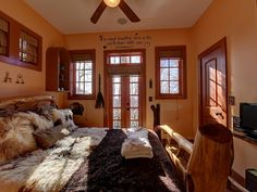 Wolf Laurel castle rental - The master suite! Walk-in closet, massive wooden bed, and french doors to...