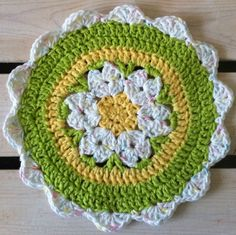 @Angie Wimberly Johnson Daisy Crochet Dishcloth I think this could be squared off and put into an afghan..