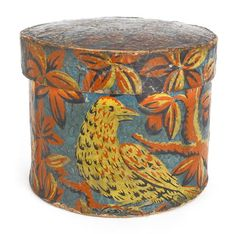 American round wallpaper box, 19th c., with colorful birds and flowers on a blue ground, 5'' h., 6 1/4'' dia.