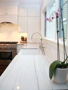 Kitchen features full overlay cabinetry with Chelsea door style, Manor Flat drawer front in Designer White enamel.