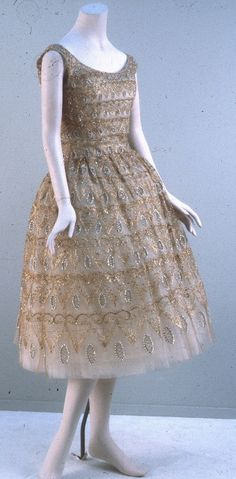Evening dress, Baghdad House Of: Dior Designer: Yves Saint Laurent Date: 1958 Media: Gold Embroidered Net, Sequins, Pearls, Gold Thread, And Beads Country: France
