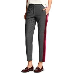 Tommy Hilfiger women's pant. An editor favorite:  The tuxedo pant gets a chic rethink courtesy of a few vibrant stripes. Go ahead, flash a little ankle, we cropped them to show off those heels.    <br/>• Sits lower on the waist, fitted through the hip and thigh. <br/>• 52% wool, 46% synthetic, 2% elastane.<br/>• Hook and bar closure, trouser styling.<br/>• Dry clean.<br/>• Imported.<br/><br/>