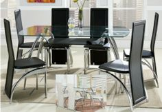 Contemporary glass-top table with 6 black or white chairs. Sale price: $399