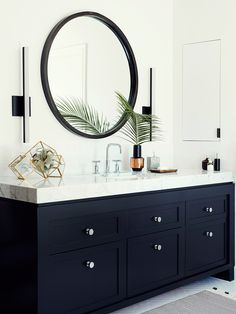 Stylish bathroom via Domaine  The built in medicine cabinet