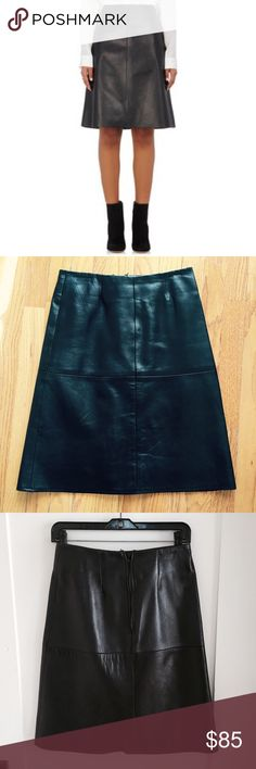 "Barneys NY black leather skirt Stunning black A-Line skirt by Barneys New York CO-OP in thick buttery soft lamb skin leather. Almost flawless, this classic skirt features a concealed back zipper, banded waist and lining. Only imperfections come from the natural texture of the leather. Waist - 26"", Length - 21.5. Size XS. Barneys New York CO-OP Skirts"