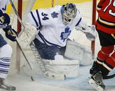 Toronto Maple Leafs' goalie James Reimer kicks away the puck during the first period of an NHL hockey game against the Calgary Flames, Friday, March 13, 2015, in Calgary, Alberta. (AP Photo/The Canadian Press, Jeff McIntosh)