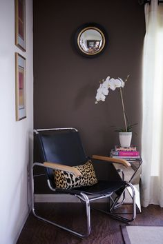 Paloma Contreras - living rooms - Behr - Aging Barrel - ivory wall, accent wall, dark brown walls, brown walls, dark brown wall color, dark ...