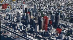 Commercial real estate company Cushman & Wakefield Commerce produced this aerial view that roughly shows what downtown Seattle would look like if all proposed developments, which are shown in red, get built. The orange blocks are projects that are under construction.