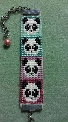 Adorable hand beaded panda bear bracelet with extender chain.