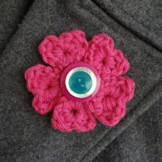 Crochet this cute and easy brooch to give your winter coat some Valentine's cheer.