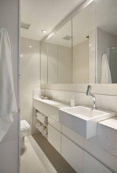 Apartamento 08 : Banheiros modernos por Estúdio Barino