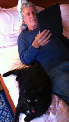 Chef and writer, Anthony Bourdain chills out with his cat.