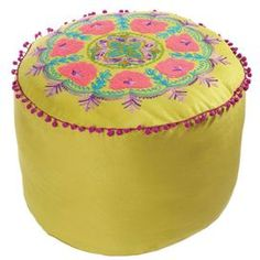Green pouf with pompom trim and embroidered floral detail.     Product: Pouf    Construction Material: Ultra suede    Color: Green and multi   Features:  Brings exotic allure to your living room, den, or master suite    Will enhance any dcor    Dimensions: 12 H x 20 Diameter    Cleaning and Care: Spot clean
