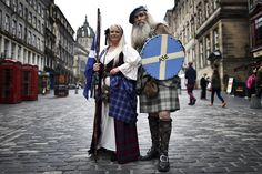 UNITED KINGDOM, Edinburgh : Pro-independence campaigners Sandy (L) and Ed Hastings pose wearing traditional Highland dress in Edinburgh, Scotland, on September ahead of the referendum on. British Party, Scottish Parliament, Outlander Book Series, Scottish Independence, Time Stood Still, Pictures Of The Week, Nbc News, Beautiful Couple, The Good Place
