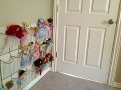 Creative Barbie Storage--cut a shoe organizer in half and staple both halves to the wall side by side... this way, a child can actually reach all of the Barbies!