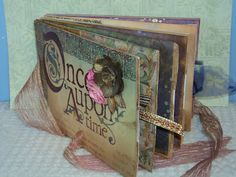 Mini Album: Made from lunch paper bags and lots of Once Apon A Time paper.