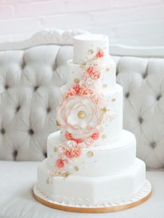 beautiful coral flowers on white cake