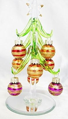Mini Crystal Christmas Tree with Colorful Striped Glitter Ornaments, http://www.amazon.com/dp/B005Q1XHVM/ref=cm_sw_r_pi_dp_uojZrb13W4FPN