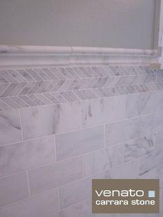 Carrara tile, crown molding, Carrara herringbone detail