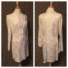 """Charlotte Russe Dress Coat Beautifully Charlotte Russe long dress coat.  Shiny cream colored, lightweight, tapestry like material.  V front with 3 buttons and two faux pockets.  Great with dress slacks and heels.  Like new.  Length from shoulder seam is 33"""" Charlotte Russe Jackets & Coats"""