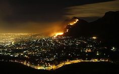 Table Mountain on fire in Cape town at night