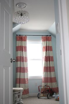 striped curtains... use painters drop cloth and paint on stipes (red or aqua)  - chandelier... for Cohen's Dr. Seuss room!